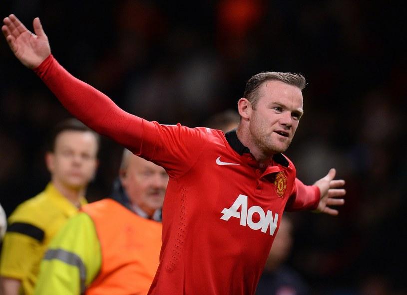 Wayne Rooney świętuje awans Manchesteru United do ćwierćfinału Ligi Mistrzów /AFP