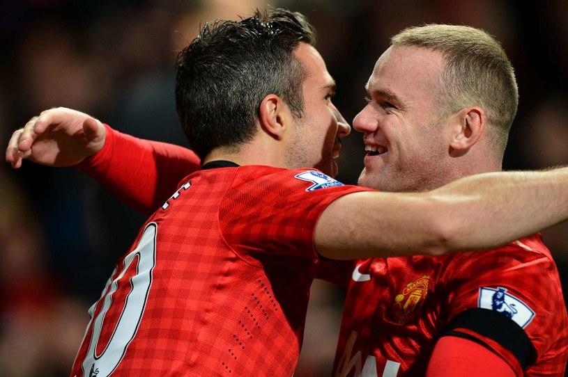 Wayne Rooney (z prawej) nie chce być zmiennikiem Robina van Persiego /AFP