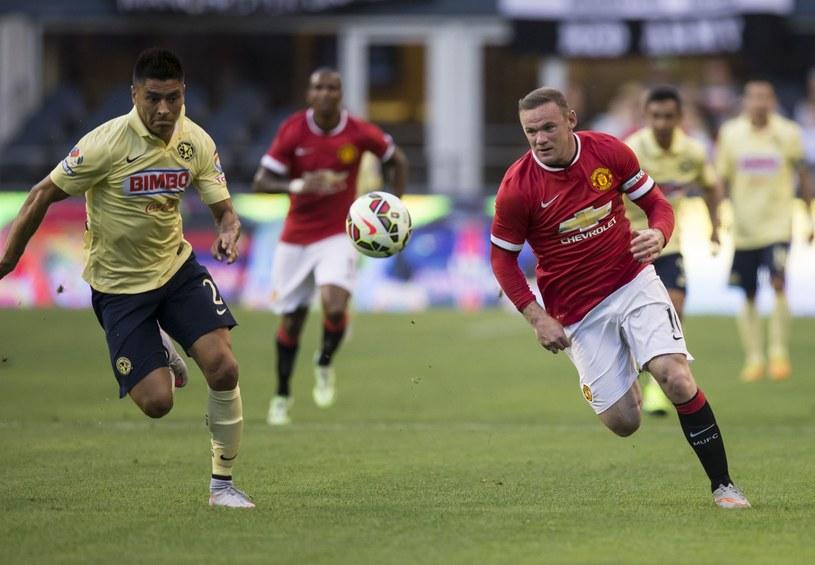 Wayne Rooney (z prawej) podczas meczu z Club America /AFP