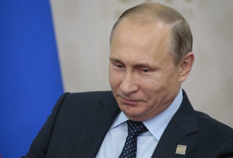 Według autora felietonu, zachodni politycy zachowująsię wobec Władimira Putina naiwnie /IVAN SEKRETAREV / POOL / AFP /AFP