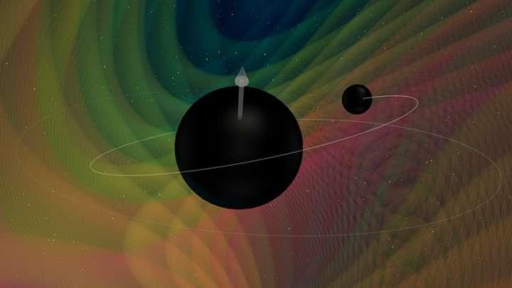 Wizja artystyczna czarnych dziur o różnej masie przed kolizją /materiały prasowe