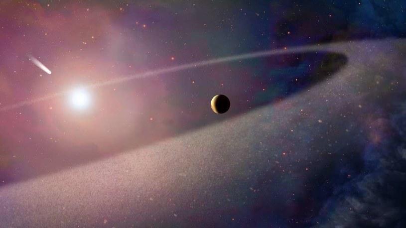 Wizja artystyczna komety opadającej na białego karła /NASA