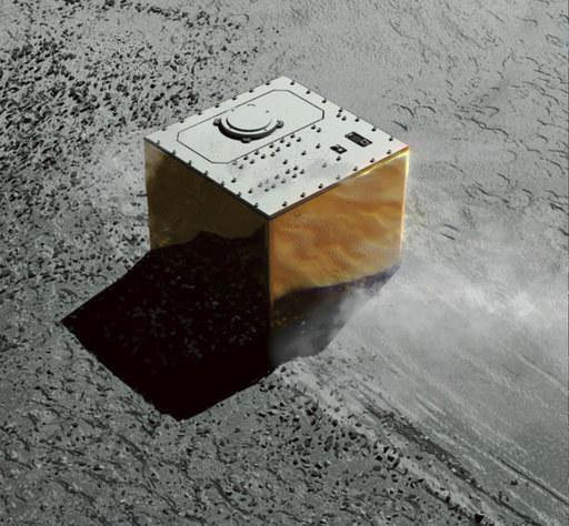 Wizualizacja próbnika Mobile Asteroid Surface Scout (MASCOT) na powierzchni Ryugu /JAXA /Materiały prasowe