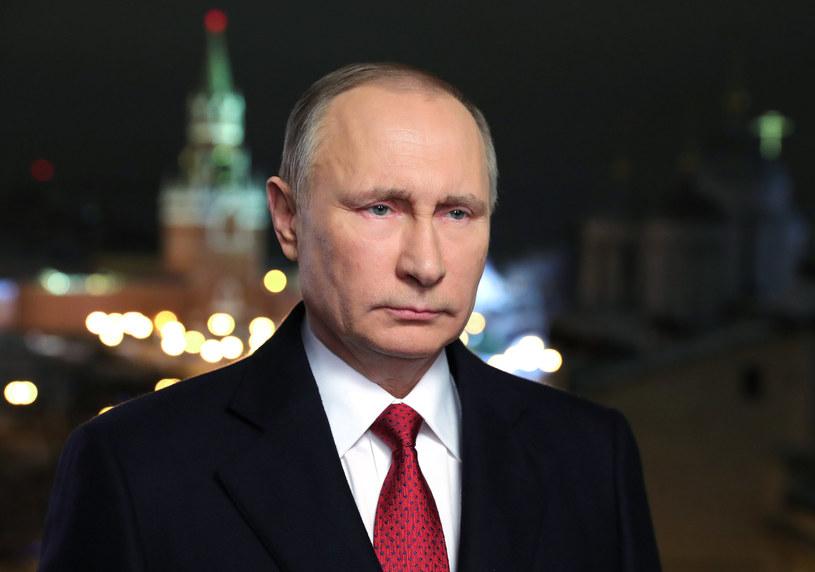 """Władimir Putin i Rosja uprawiają """"wojnę informacyjną"""" /Mikhail KLIMENTIEV / Sputnik /AFP"""