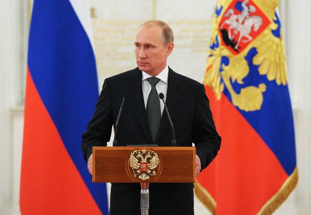 """Władimir Putin: """"W ruch coraz częściej idą siłowe dźwignie nacisku"""" fot. Michael Klimentyev /AFP"""