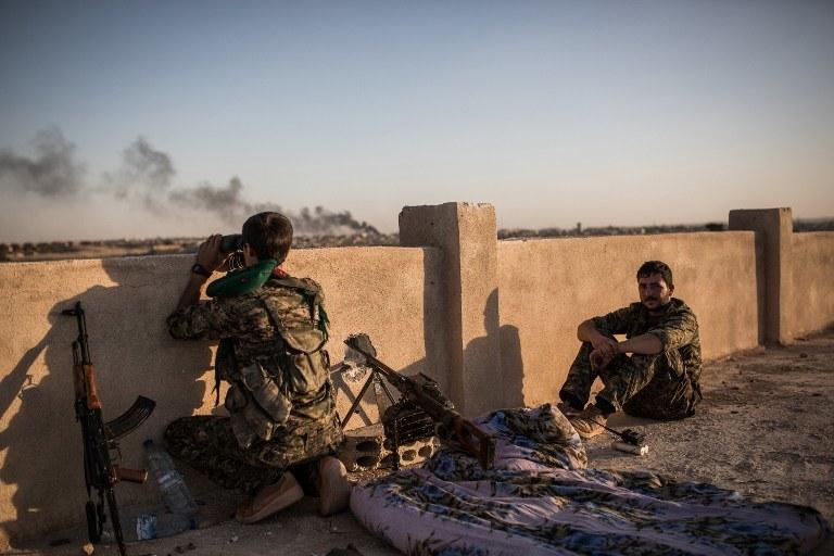 Wojna z IS to pretekst do bombardowania kurdyjskich baz? Na zdj. kurdyjscy bojownicy /UYGAR ONDER SIMSEK / AFP /AFP