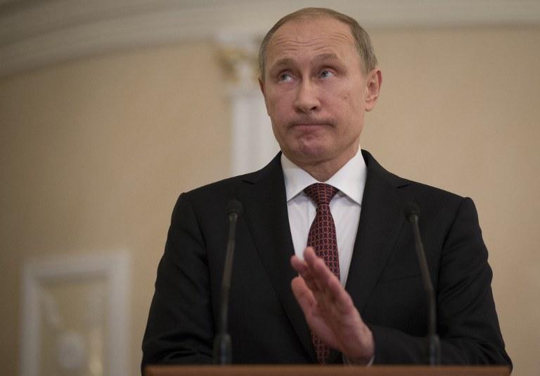 """""""Wyjście z twarzą"""" wiąże się z zawieszeniem konfliktu; na fot. Władimir Putin, zdj. ilustracyjne /ALEXANDER ZEMLIANICHENKO / POOL / AFP /AFP"""