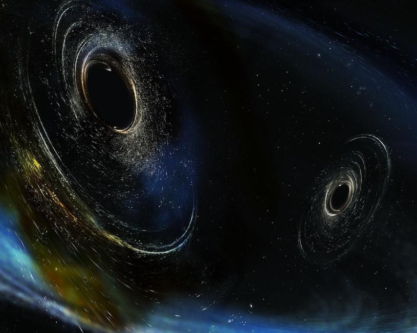 Wyobrażenie czarnych dziur, których zderzenie mogło doprowadzić do emisji fal grawitacyjnych /materiały prasowe