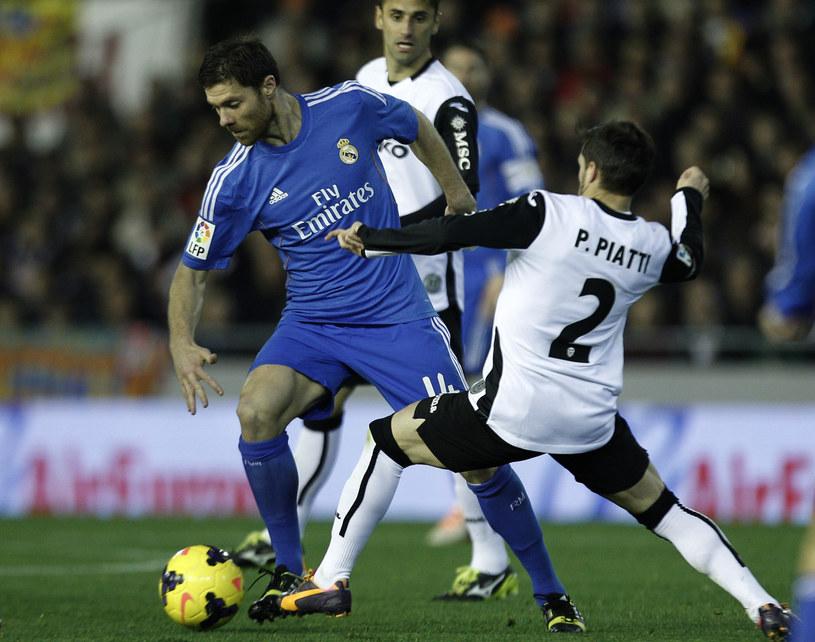 Xabi Alonso w meczu z Valencią /AFP