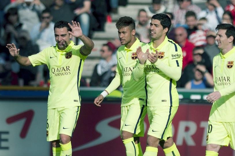 Xavi, a za jego plecami Neymar, Suarez i Messi /AFP