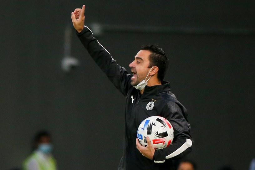 Xavi chciałby kiedyś wrócić do Barcelony jako trener. Obecnie prowadzi katarski Al-Sadd. /AFP