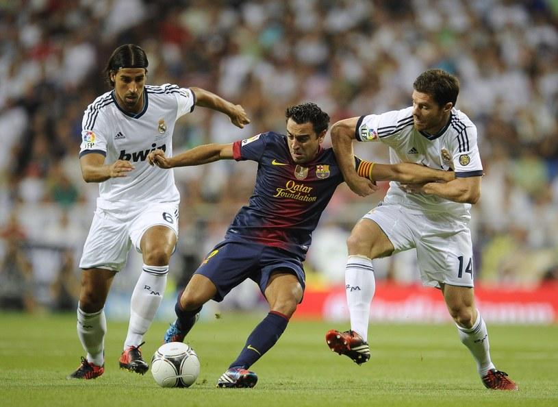 Xavi Hernandez w meczu z Realem Madryt /AFP