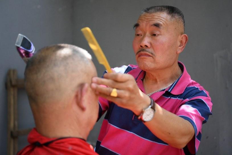 Xiong Gaowu ma 40-letnie doświadczenie w swym nietypowym zawodzie /East News