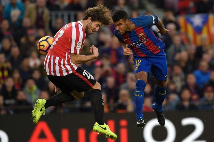 Yeray Alvarez (L) w meczu ligi hiszpańskiej z Barceloną /AFP