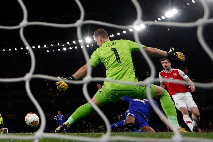 Youssef El-Arabi i jego strzał rozpaczy rzucił na łopatki Arsenal, a ucieszył Olympiakos. /AFP