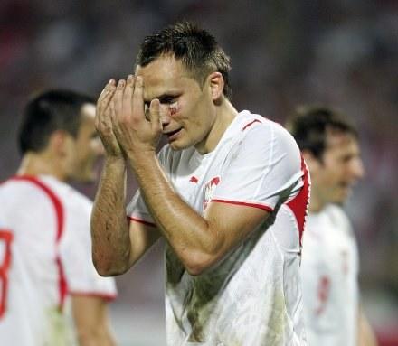 Z ostatnim występem w reprezentacji (przeciwko Finlandii) Arek ma niezbyt miłe wspomnienia /AFP