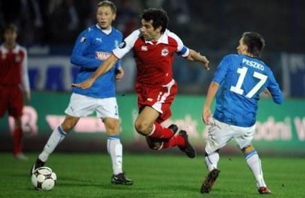 Z prawej Sławomir Peszko podczas meczu z Deportivo La Coruna /AFP