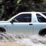 Z zewnątrz Land Rover w środku BMW