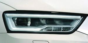 Za w pełni diodowe reflektory w przypadku Q3 trzeba dopłacić 4010 zł, niezależnie od wersji wyposażenia. (kliknij, żeby powiększyć) /Motor