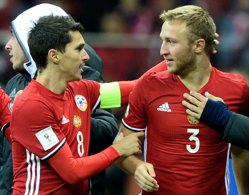 Zawodnicy Armenii Varazdat Harojan i Marcos Pizzelli (L) /AFP