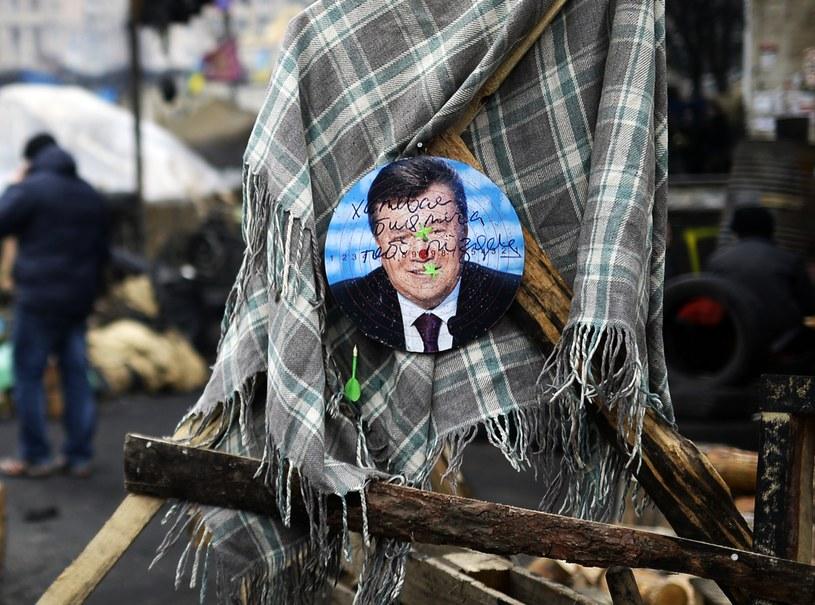 Zdjęcie Wiktora Janukowycza na kijowskim Majdanie /AFP