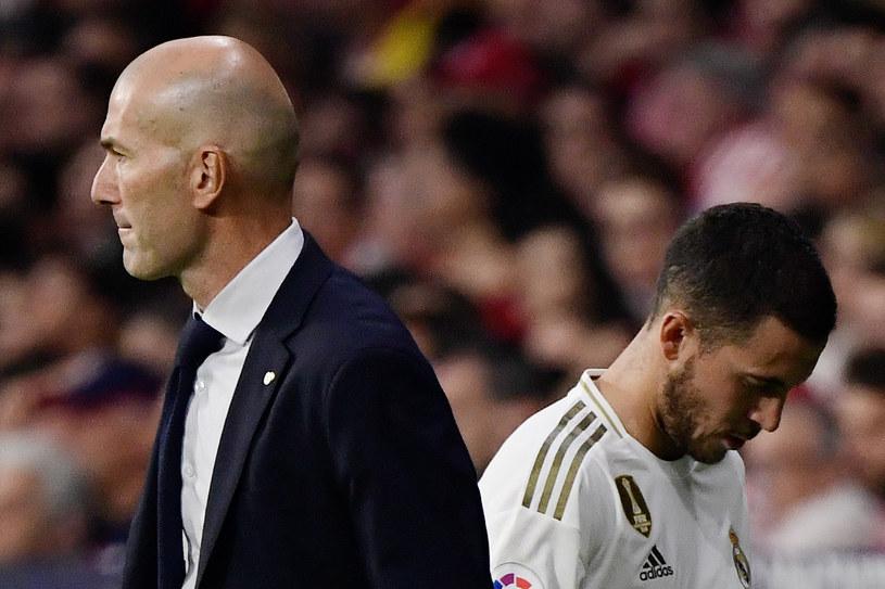 Zinedine Zidane (po lewej) i Eden Hazard. Dla nich Real Madryt to klub życia /JAVIER SORIANO /AFP