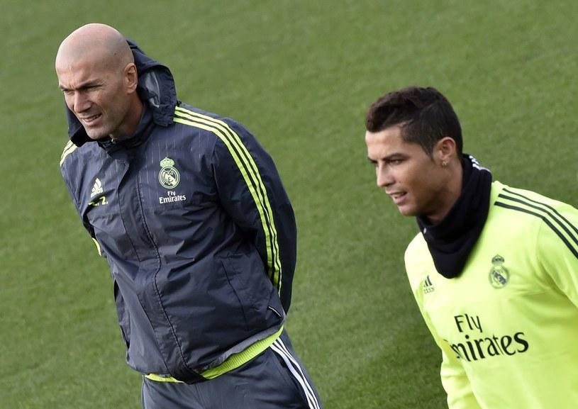 Zinedine Zidane (z lewej) i Cristiano Ronaldo /AFP