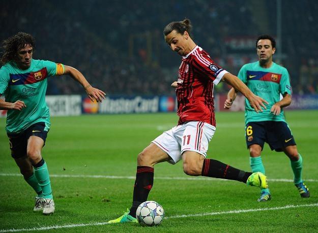 Zlatan Ibrahimovic stoczył mnóstwo pojedynków z Carlesem Puyolem (z lewej) /AFP