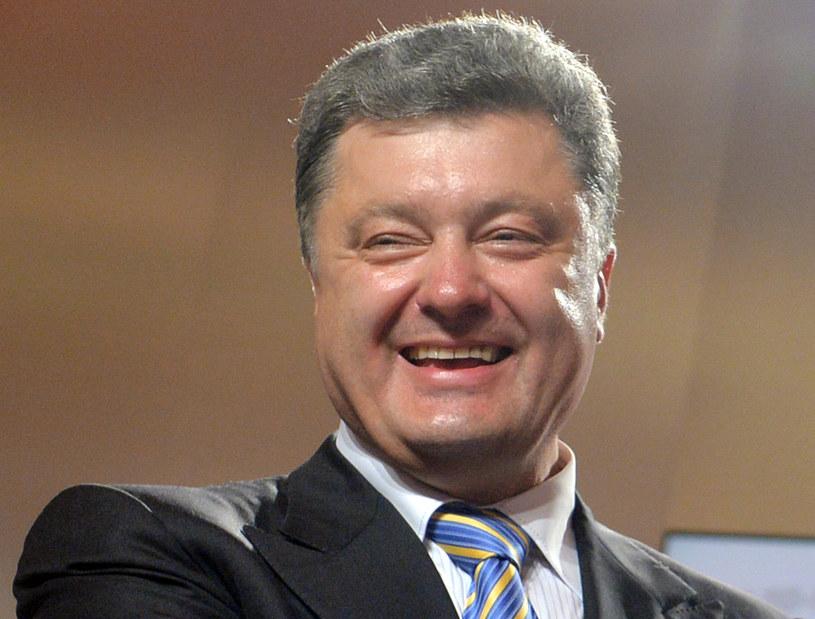 Zwyciężył biznesmen i były szef dyplomacji Petro Poroszenko. /AFP